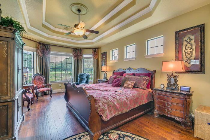 9624-san-fernando-ct--howey-in-the-hills--fl-34737---26---master-bedroom.jpg