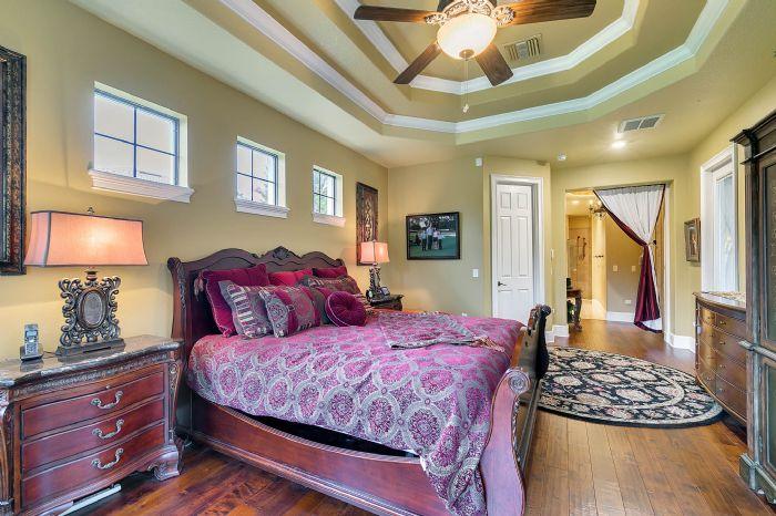 9624-san-fernando-ct--howey-in-the-hills--fl-34737---28---master-bedroom.jpg