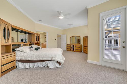 10909-Emerald-Chase-Dr--Orlando--FL-32836---22---Master-Bedroom.jpg