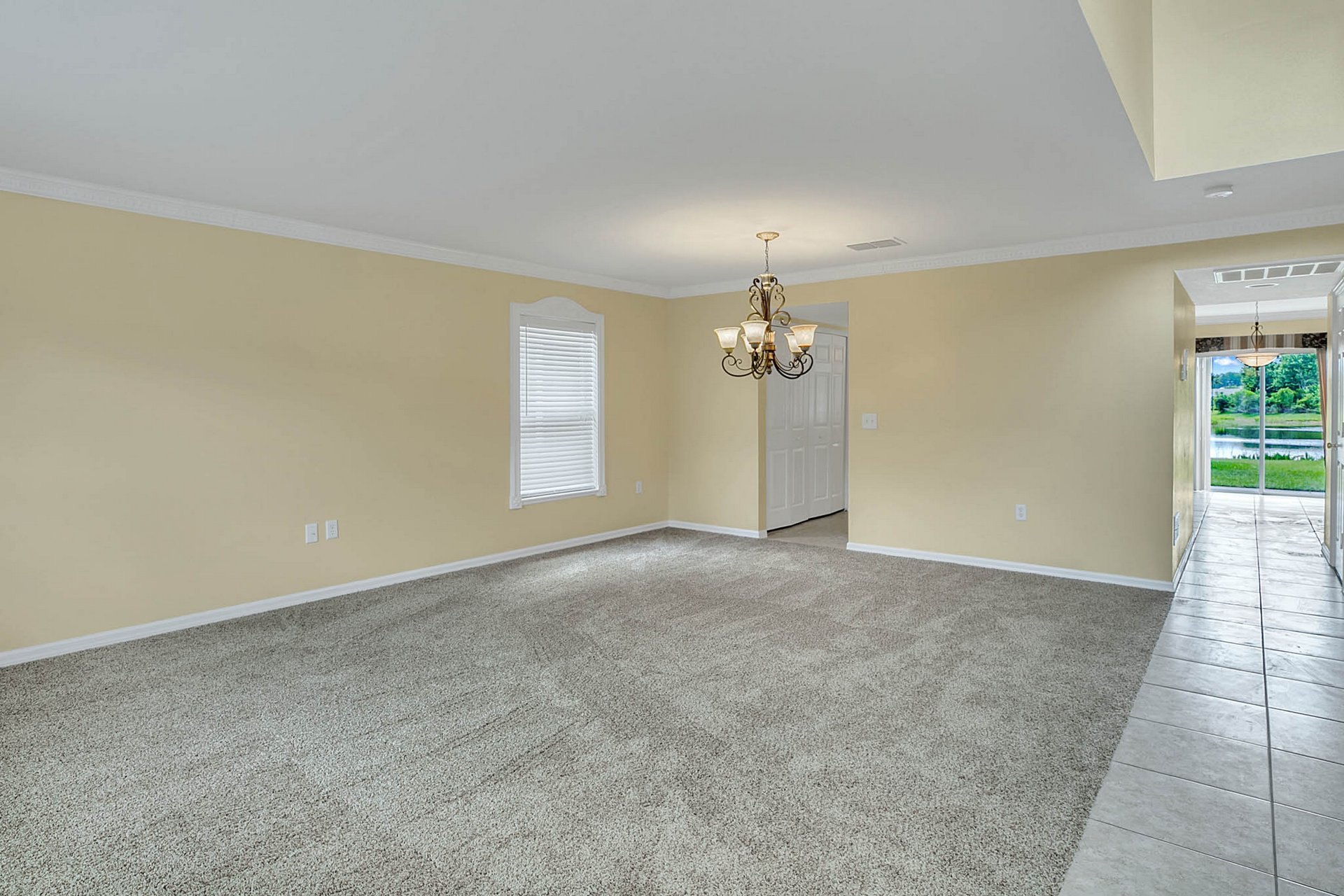 3205-Bellericay-Ln.-Land-O-Lakes--FL-34638--04--Living-Room---Dining.jpg