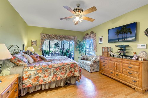 23115-Glory-Rd--Howey-In-The-Hills--FL-34737----24---Master-Bedroom.jpg