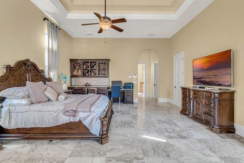 7726-Markham-Bend-Pl--Sanford--FL-32771----23---Master-Bedroom.jpg