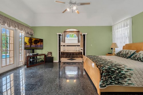 9208-Bay-Hill-Blvd--Orlando--FL-32819----19---Master-Bedroom.jpg