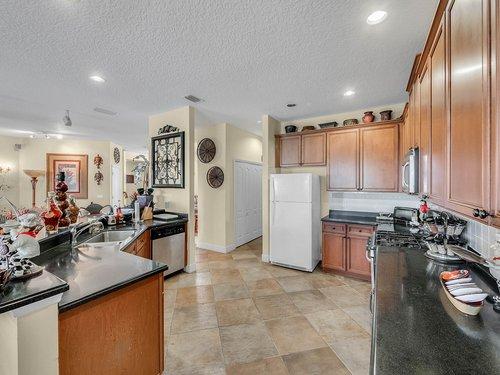 114-Oak-Haven-Cir--DeLand--FL-32720----14---Kitchen.jpg