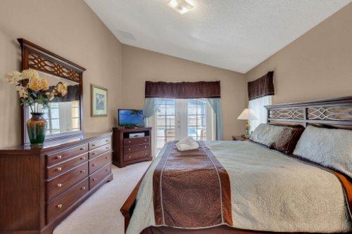 16018-Hawk-Hill-St--Clermont--FL-34714----18---Master-Bedroom.jpg
