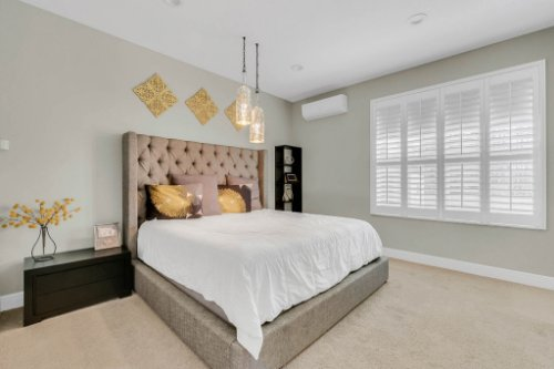 5008-Whistling-Wind-Ave--Kissimmee--FL-34758----21---Master-Bedroom.jpg