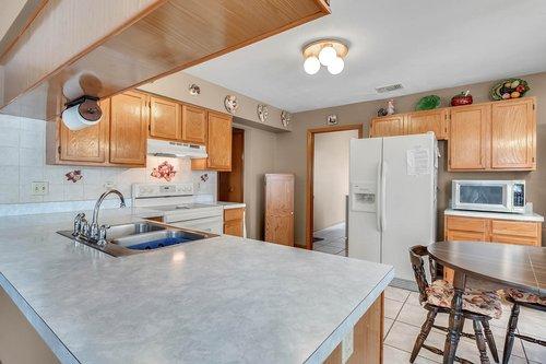 5107-Scarsdale-Manor-Ln--Orlando--FL-32818----14---Kitchen.jpg